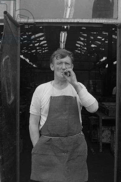 Worker taking a break, Sutcliffs, Wakefield, 1972 (b/w photo)