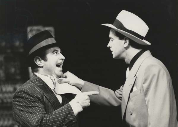 Bob Hoskins as Nathan Detroit and Ian Charleson as Sky Masterson in 'Guys and Dolls' at the National Theatre, 1982 (b/w photo)