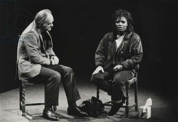 Oliver Ford Davies as The Reverend Lionel Espy and Joy Richardson as Stella Marr in 'Racing Demon' at the National Theatre, 1990 (b/w photo)