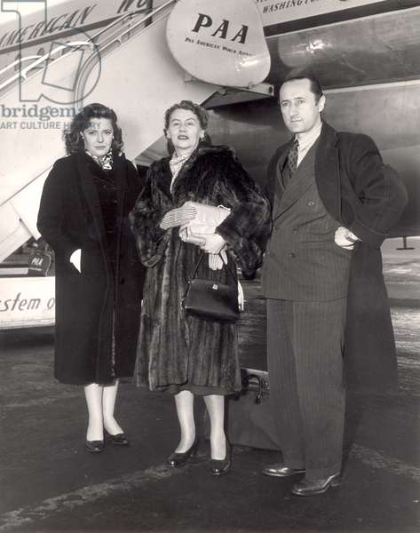 Sonia Orwell, Joy Batchelor and John Halas arrive at Idlewild airport for the opening of the animated film of 'Animal Farm' in January 1954 (b/w photo)