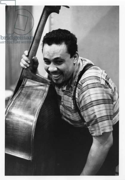 Charles Mingus recording 'Ah Um' with a trombonist, 1959 (b/w photo)
