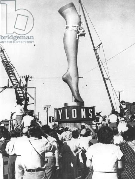 A two-ton model of actress Marie Wilson's leg, produced to advertise a Los Angeles hosiery shop (b/w photo)