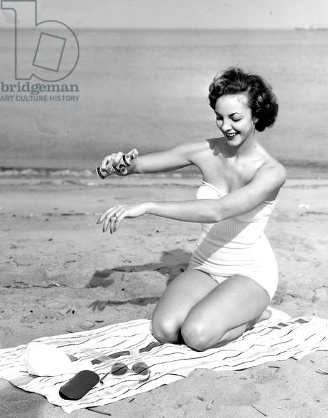 Sun tan oil aerosol, c.1950s (b/w photo)