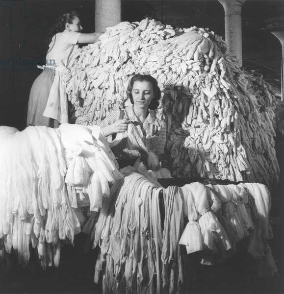 Inspection of nylon hosiery, c.1950 (b/w photo)