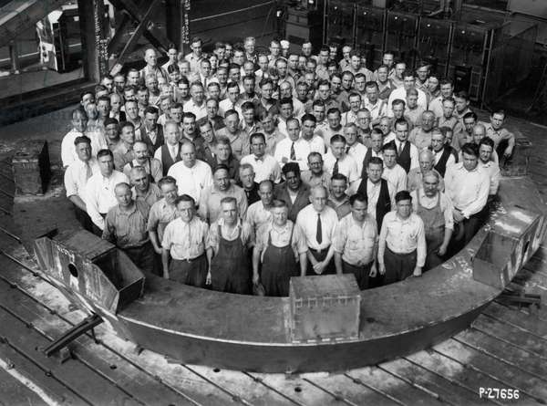 Employee group portrait, within a section of the Hale Telescope, c.1936-48 (b/w photo)