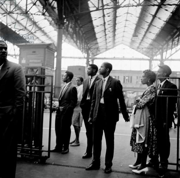 Windrush migrants arriving at Waterloo Station, London, 1962 (b/w photo)