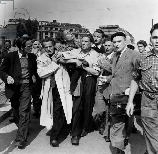An injured protestor being carried away from the demonstrations, 17th June 1953 (b/w photo)