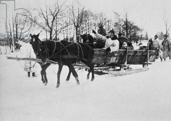 Wounded soldiers transported to the sick bay, Poland, winter 1914/15 (b/w photo)