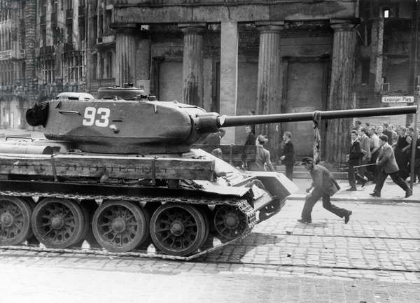 Protestors thrown stones at a Soviet tank, Leipzig Square, Berlin, 17th June 1953 (b/w photo)