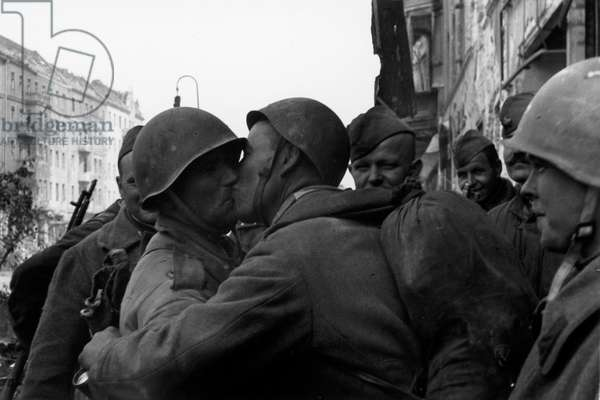 Soviet soldiers embrace at the end of WWII, Berlin 1945 (b/w photo)