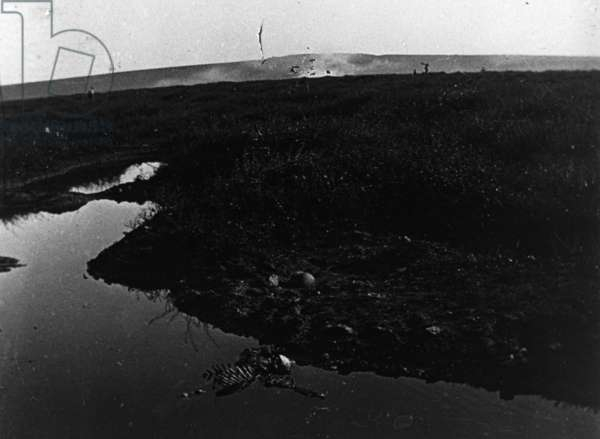 Shell crater containing human remains, Fleury, France, 1914-18 (b/w photo)