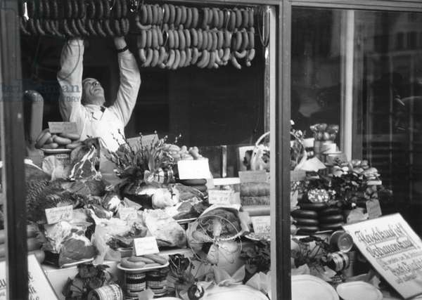 Shop window in West Berlin (butcher)  displaying goods following the lifting of the Berlin Blockade (24th June 1948 - 11th May 1949), Berlin, 1949 (b/w photo)