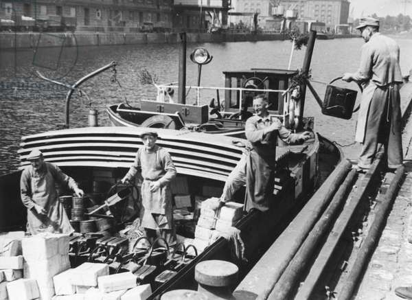 The first West German barge to deliver goods to West Berlin following the end of the Berlin Blockade (24th June 1948 - 11th May 1949), Berlin, 17th May 1949, (b/w photo)