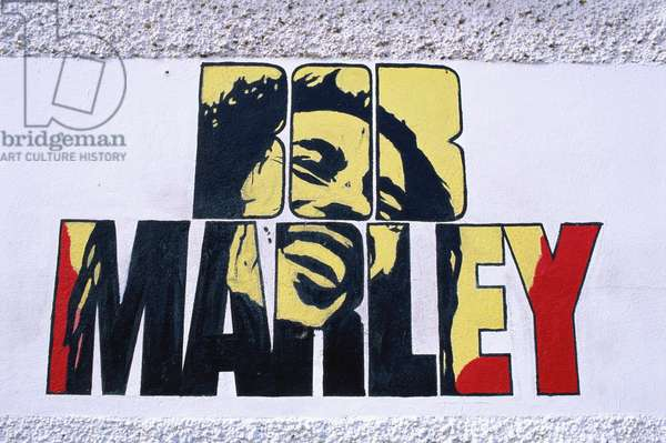 Bob Marley (full name Robert Nesta Marley) - portrait of the Jamaican reggae singer and composer on a wall mural at the Bob Marley Museum in Kingston. Painted by Carribean artists. BM: 6 February 1945 - 11 May 1981.