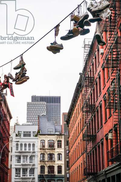 Shoes hanging from powerline, Soho, Manhattan (photo)
