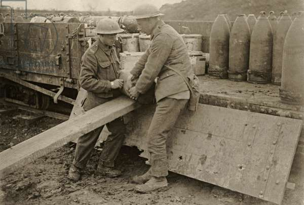 British soldiers unloading heavy shells, Wesern Front, 1914-18 (b/w photo)