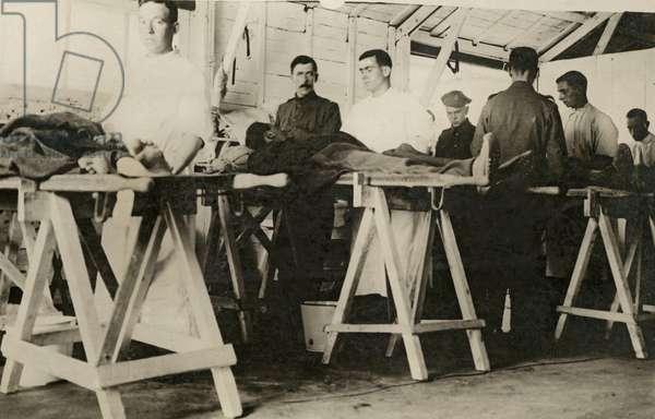 Scene in an advanced dressing station, Flanders, 1914-18 (b/w photo)