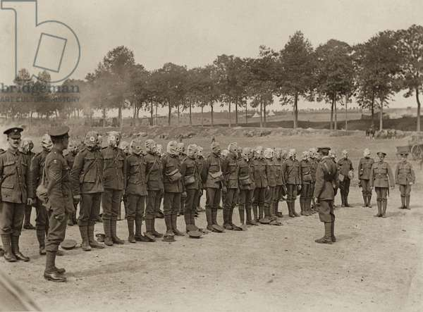 Respirator drill for the Irish Guards on the Amiens-Albert road near the Somme, September 1916 (b/w photo)
