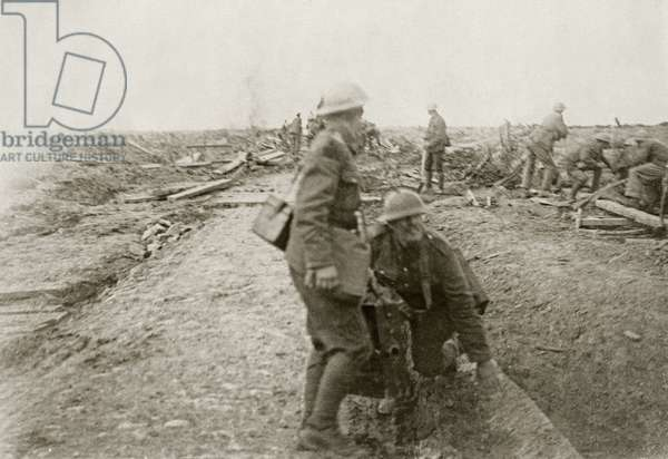 British soldiers repairing a road under fire near Ypres, 1914-18 (b/w photo)