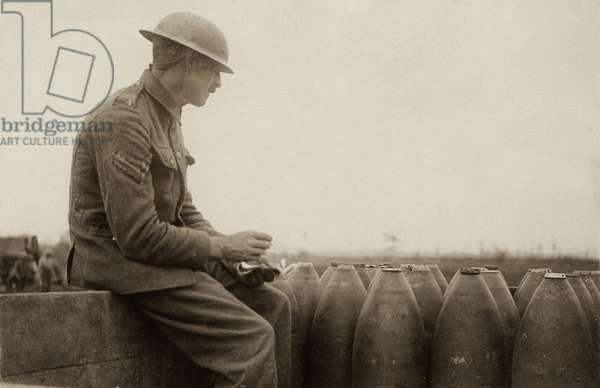 British corporal checking shells arriving on a light railway, Western Front, 1914-18 (b/w photo)