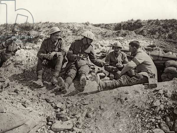 French and British soldiers share rations at the front, France, 1914-18 (b/w photo)