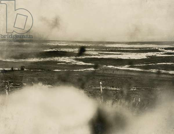 Trenches on the Western Front, with soldiers advancing in the distance, 1914-18 (b/w photo)
