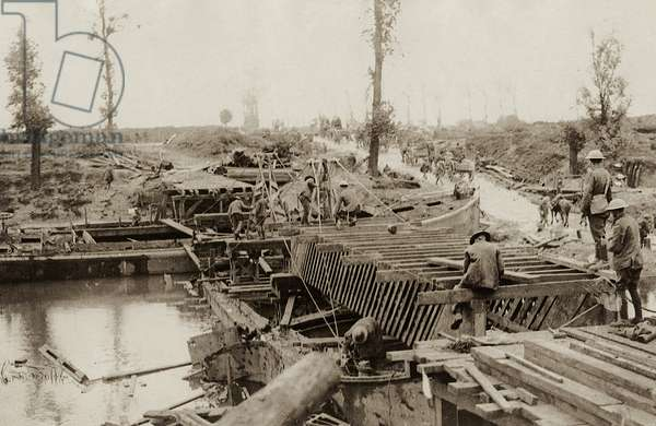 British soldiers bridging the Yser north of Ypres, Belgium, 1914-18 (b/w photo)
