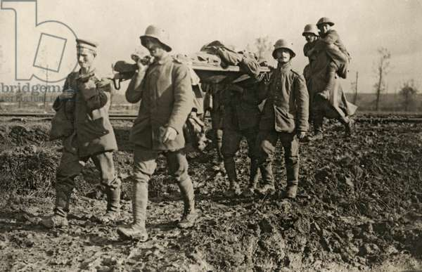 German prisoners bringing in the wounded during the Battle of the Menin Road, Flanders, September 1917 (b/w photo)