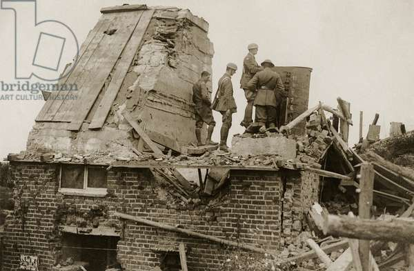 British soldiers atop a captured German observation post, Western Front, 1914-18 (b/w photo)