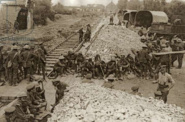 British troops move stones for road repairs, Battle of Flanders, 1914-18 (b/w photo)