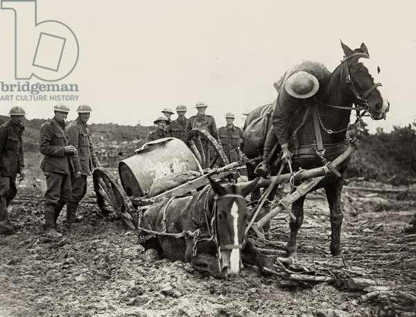 British troops struggling in the mud, Flanders, 1914-18 (b/w photo)