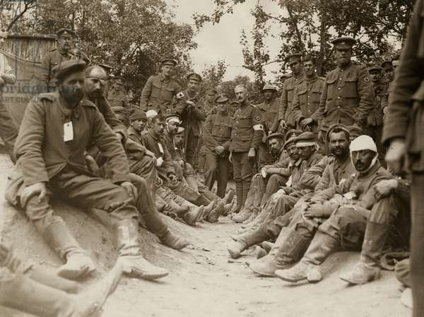 Soldiers and medics with German prisoners, Western Front, 1914-18 (b/w photo)