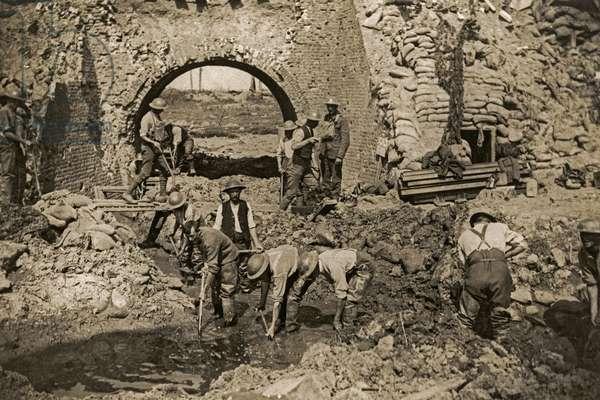British soldiers draining captured ground, Flanders, 1914-18 (b/w photo)