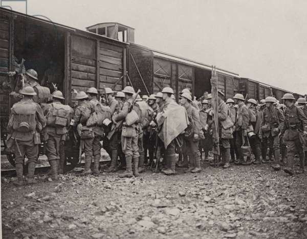 Men of a Midland Regiment boarding a train after fighting in the trenches of Flanders, 1914-18 (b/w photo)
