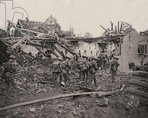London troops seeking their billet in a newly captured Flanders village, 1914-18 (b/w photo)