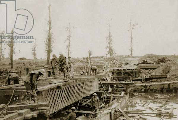 Bridging the Yser during an advance north of Ypres, Flanders, 1914-18 (b/w photo)