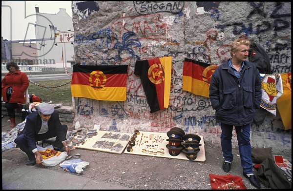 The sale of fragments of the Berlin Wall and other souvenirs from East Germany and the Soviet Union, beside the former allied border crossing Checkpoint Charlie, 30th March 1990 (photo)