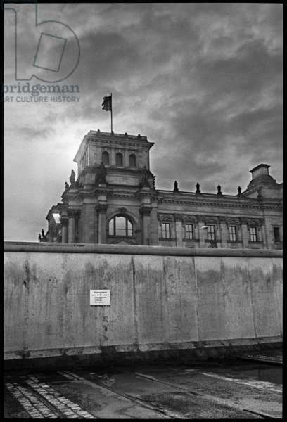 The Berlin Wall, with the West German parliament building in the background, 1981 (b/w photo)