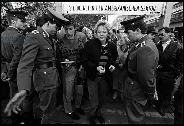 Border control check the passes of citizens returning to the GDR after having visit West Berlin, Checkpoint Charlie, Bezirk, Kreuzberg, 10th November 1989 (b/w photo)