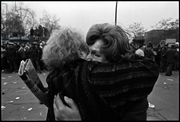 Two Berliners embrace with joy following the opening of the Berlin Wall, 12th November 1989 (b/w photo)