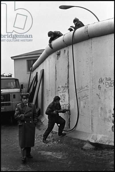 DDR officials dismantling part of the Berlin Wall to create a border crossing on Heinrich Heine Street, Berlin, 6th December 1989 (b/w photo)