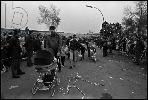 East Berliners taking their children to visit West Berlin for the first time, 12th November 1989 (b/w photo)