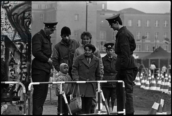 Border officials at the newly opened checkpoint in Potsdam Square, East Berlin, 13th November 1989 (b/w photograph)