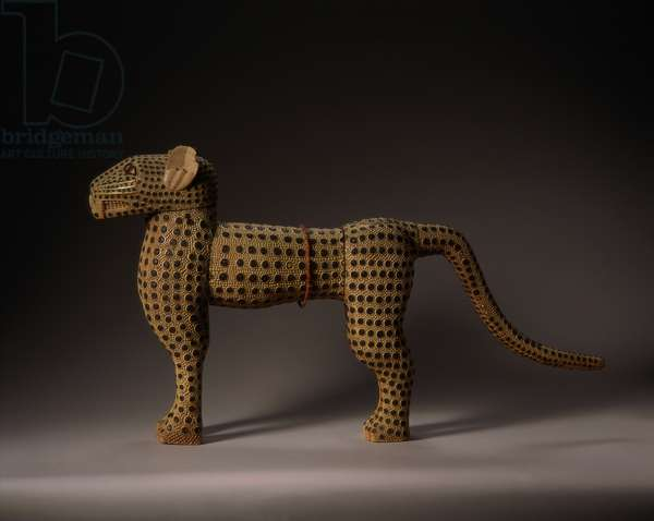 A leopard, Benin, Nigeria, 19th century (ivory and copper)