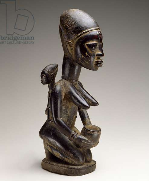 Mother and child figure, Nigeria, late 19th century (wood and traces of indigo)