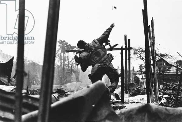 American Marine throwing hand grenade, Tet Offensive, Hue, South Vietnam, 1968 (gelatin silver print)