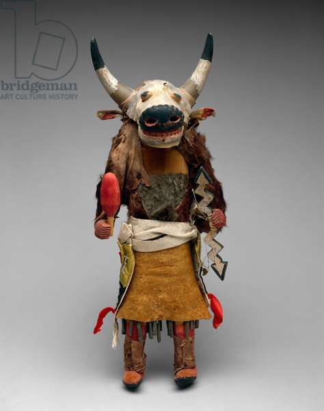 Zuni Pueblo buffalo kachina doll, c.1915 (wood, paint, feathers, horns, leather, buffalo fur, rawhide, cotton, satin ribbon, tin, nails, and string)