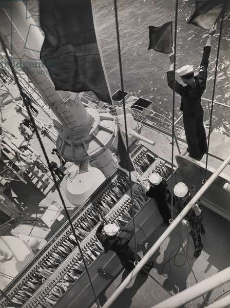 Navy Signalman using semaphore flags as he communicates with another ship while Signalmen handle the signal flag hoists on board the USS Maryland, San Pedro, CA, 1939 (gelatin silver print)
