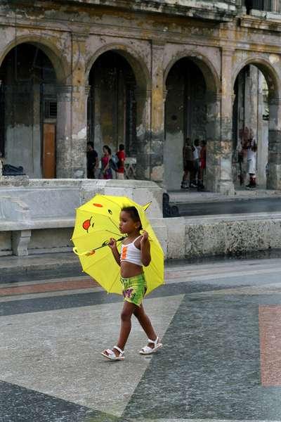 Little girl with umbrella, Havana, Cuba (photo)
