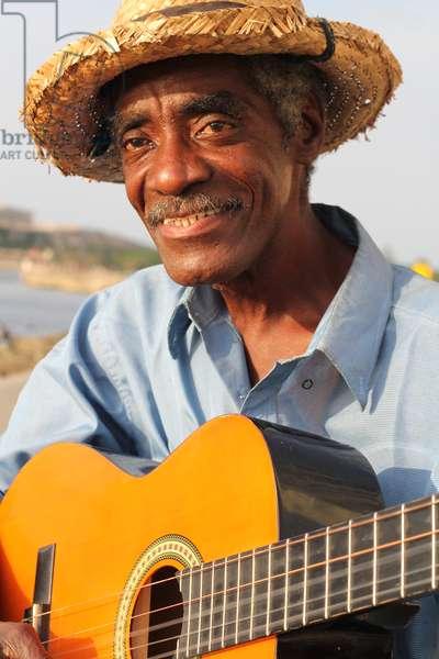 Man with guitar, Havana, Cuba (photo)